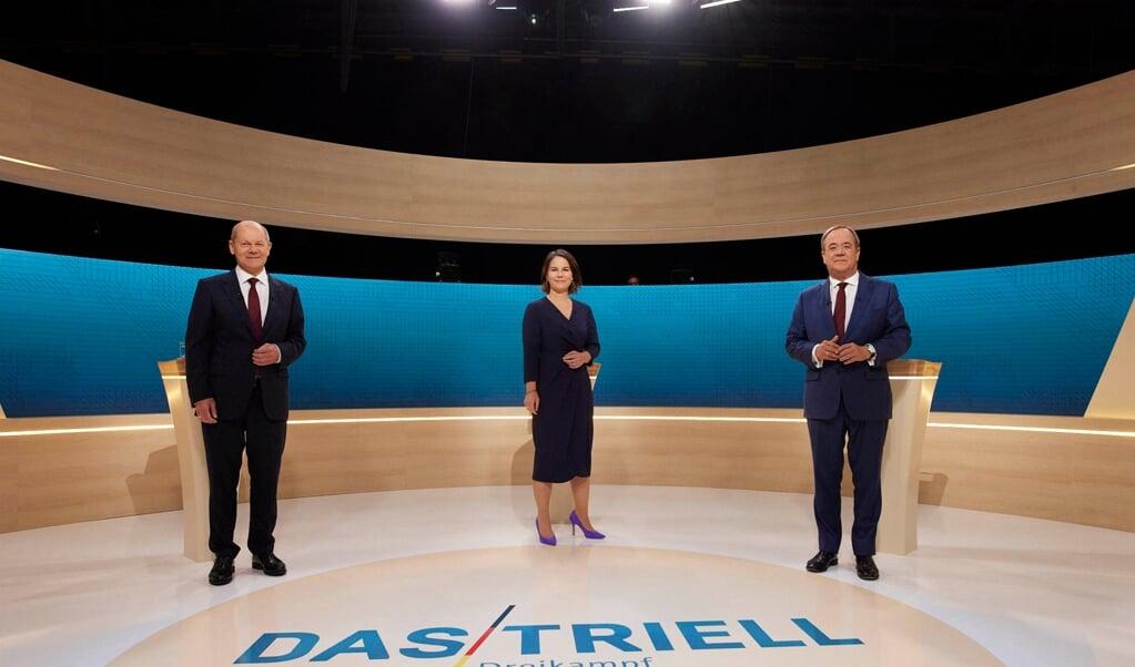 Olaf Scholz, Annalena Baerbock og Armin Laschet tørnede denne gang sammen på ARD og ZDF efter den første duel på de private tv-stationer for 14 dage siden.    (Laurence Chaperon/ARD/obs)
