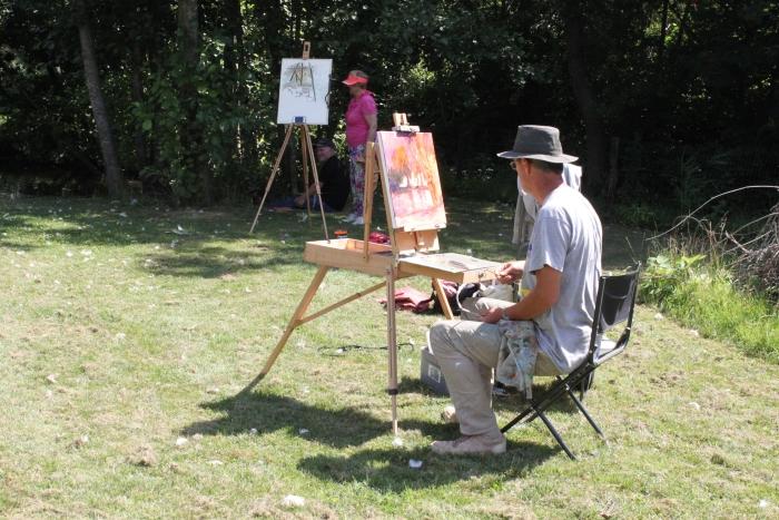 Paul Haring, schilderen in de tuin van Tico