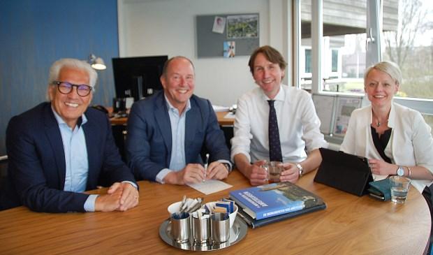 Ruud Kootker en Peter Bot van BBA (links) met de informateurs Herbert Raat (VVD) en Floortje Gordon (D66).