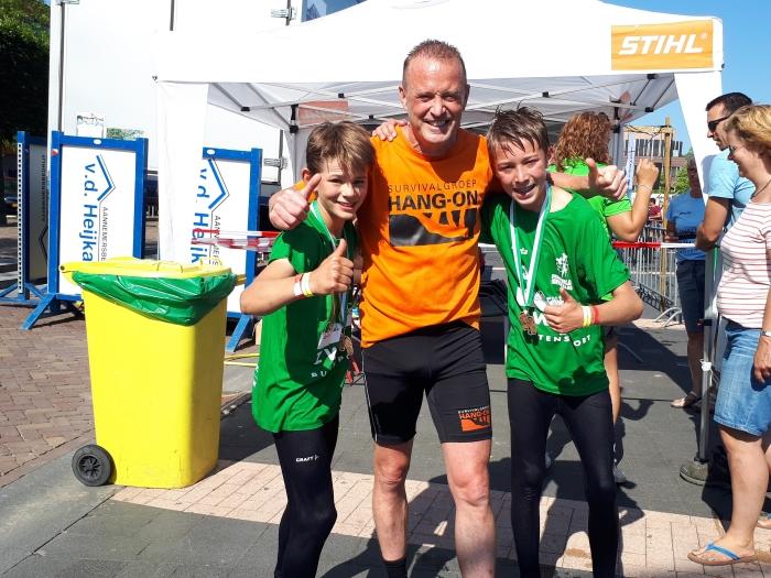 Trainer Erik de Heer met Teije en Niels
