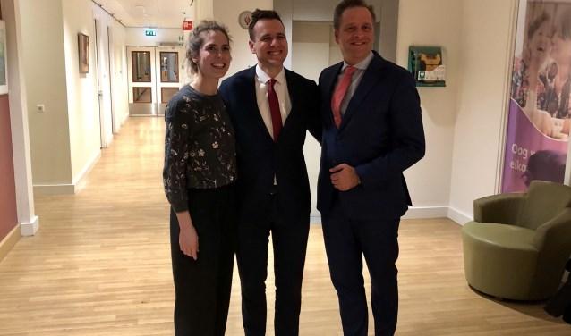 Wethouders Kukenheim (Amsterdam) en Van Ballegooijen (Amstelveen) met de minister.