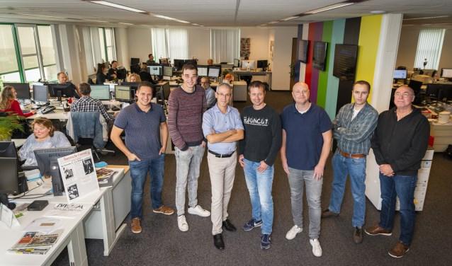 Een deel van het team dat werkt aan EdeStad Premium. Derde van links staat Hoofd Content Norbert Witjes