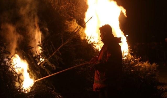 Traditionele verbranding van kerstbomen nog van deze tijd?