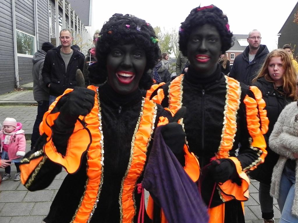 Deze Zwarte Pieten hadden de grootste schik met snoep uitdelen. Richard Thoolen © BDU media