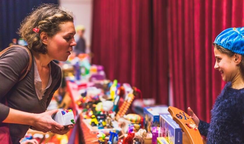 Een speelgoedruilmarkt van Recycle Sint.