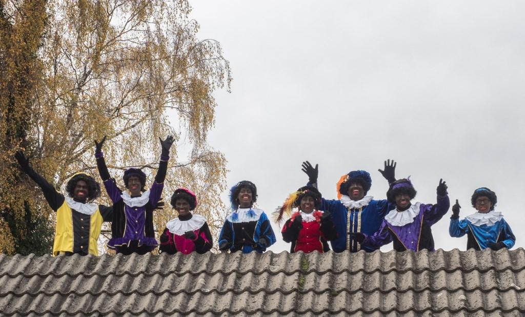 De 'Kado Pieten' gaan over de daken. Ab van den Pol © BDU media