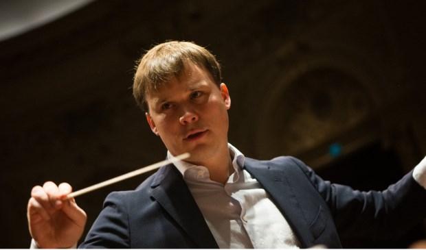 Dirigent Carel den Hertog.