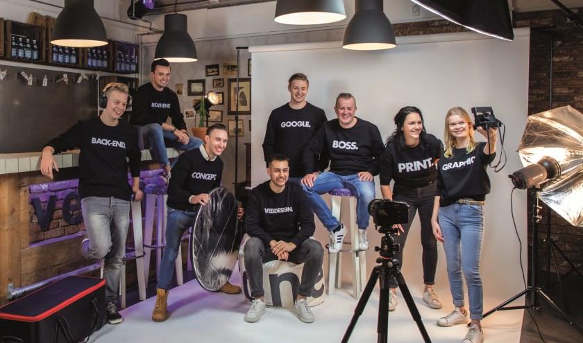 Het team van Veconet in de eigen fotostudio.
