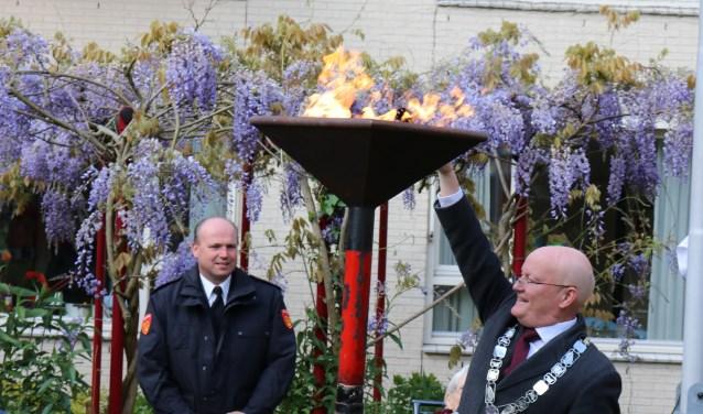 Ontsteken van het bevrijdingsvuur door de burgemeester