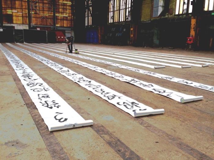 Deelnemer Kunstmanifestatie Loi Che Chan Kalligrafie