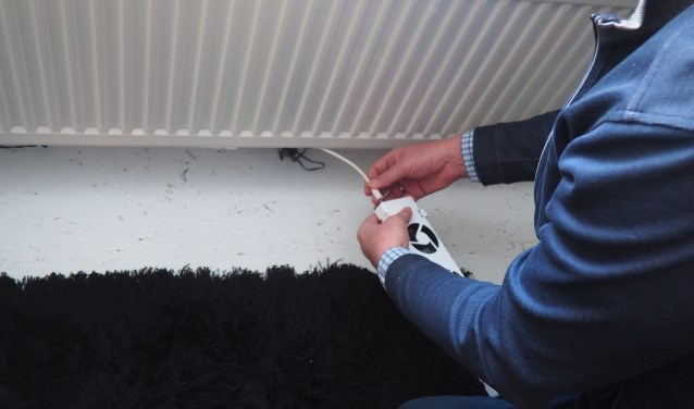 Speedcomfort maakt kleine ventilatoren die onder een radiator worden bevestigd.