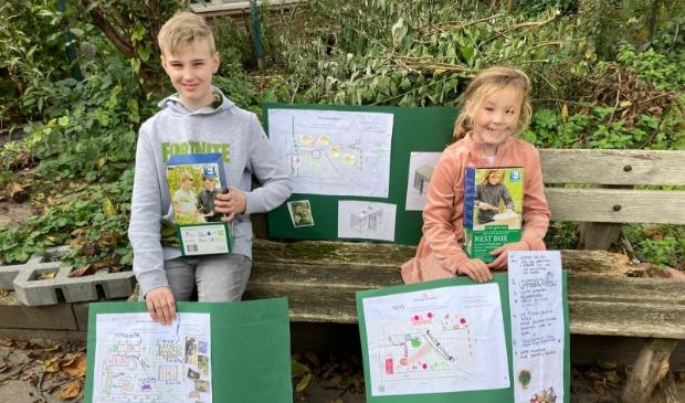 Blije winnaars van de tuintekenwedstrijd