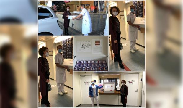 Monique Vlasveld overhandigt de dozen met chocolade aan Dr. Stolk en Elizah Winklaar