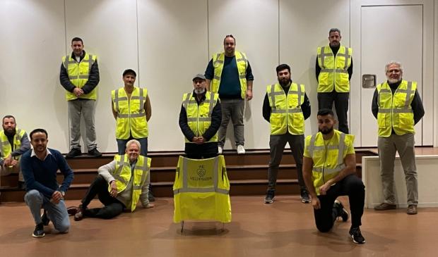 Een aantal deelnemers van 'Samen voor een veilig Veldhuizen na teambuilding in het Kernhuis