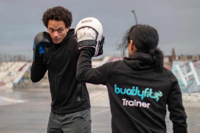 Marvin Brandon en Clark Boyé in een oefeningen tijdens de Mixed Fight Workout