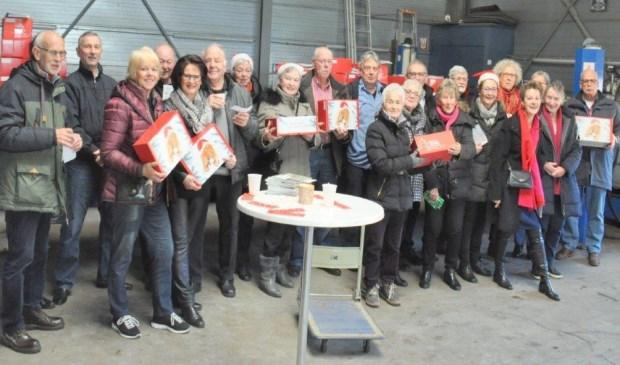 Zonnebloem vrijwilligers bezig met het distributieplan van de RIKI pakketten.