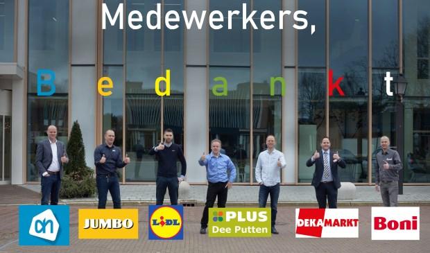 De supermarktmanagers geven een signaal af naar hun medewerkers.