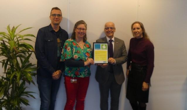 Op de foto staan v.l.n.r.: Michel de Bruin (vrijwilligerscoördinator), Monica van den Berg (vrijwilligerscoördinator), Peter de Wit (bestuurder) en Annelies Lodder (vrijwilligerscoördinator).