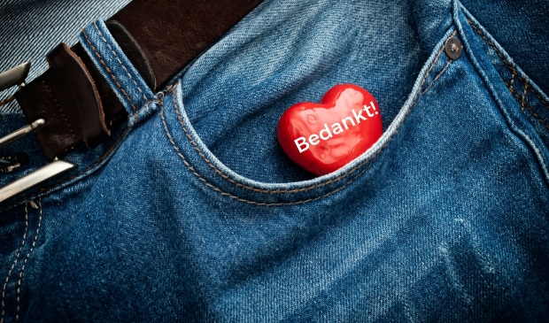 Red heart in the pocket of jeans trousers.