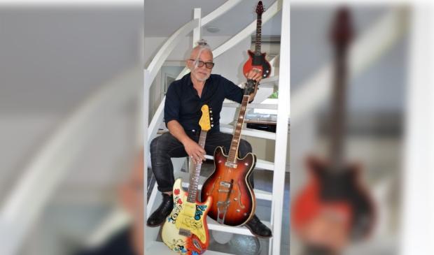 Glasmacher met zijn oudste gitaar (rechts) en zijn meest recente gesponsorde exemplaar (onder) Henny Jansen © BDU Media