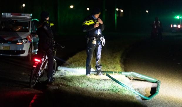 De politie neemt de schade op bij het vernielde hek Koen Laureij © BDU media