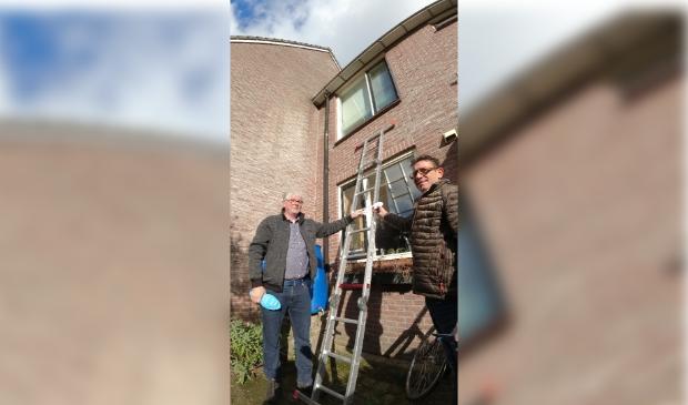 Een ladder voor het grijpen, poortdeur niet op slot