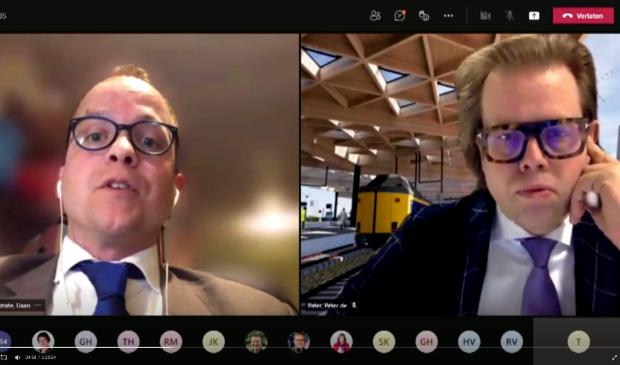 <p>Daan Westrate (CU) &nbsp;en wethouder Peter de Pater tijdens de online raadsvergadering</p>