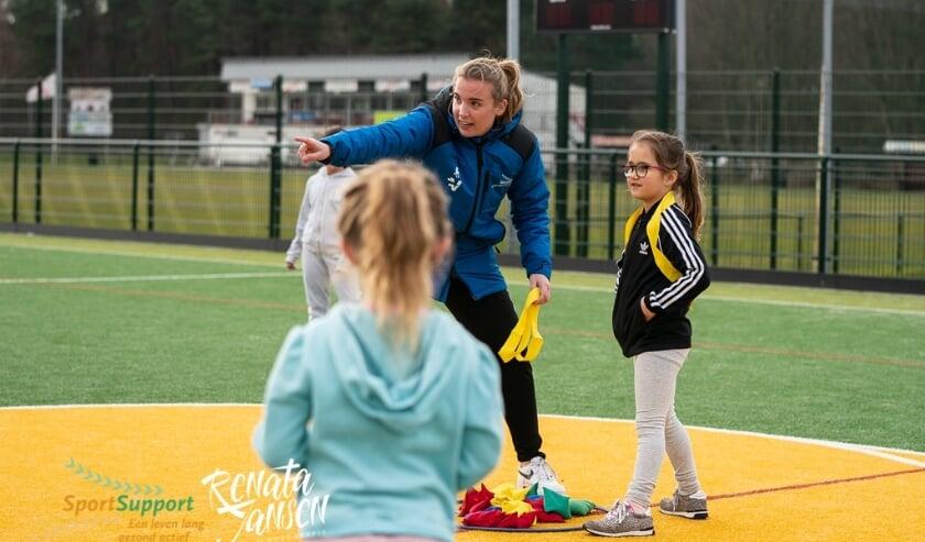 Sport en spel op het veld of plein in Velsen