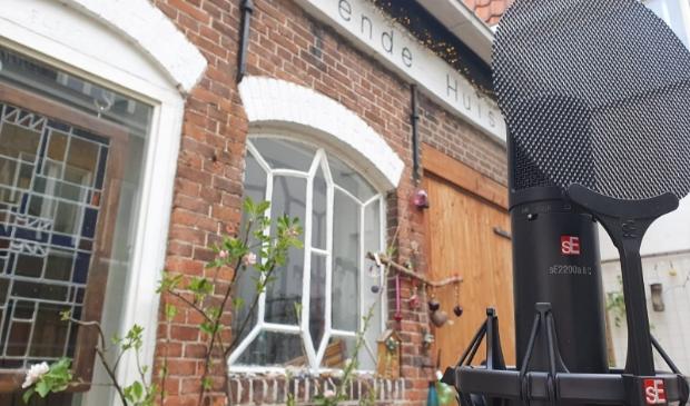 het zevende Huis en een microfoon