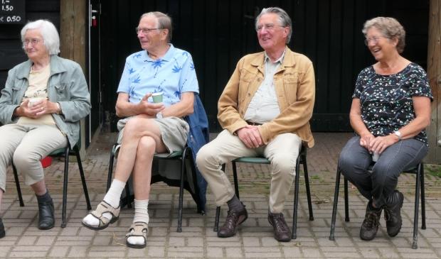 Vier aktieve vrijwilligers bijeen.