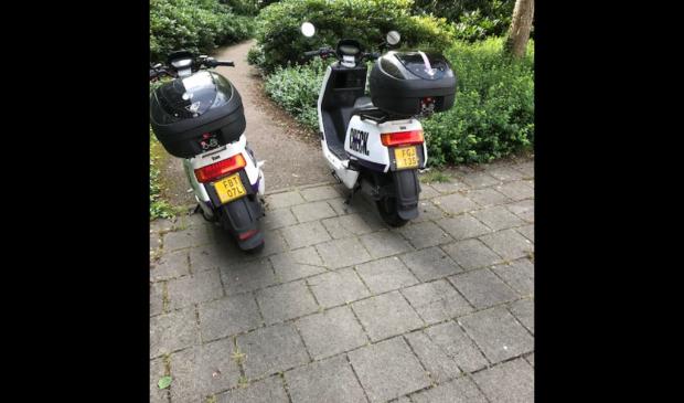 Blokkeren van voetpad door Check scooters