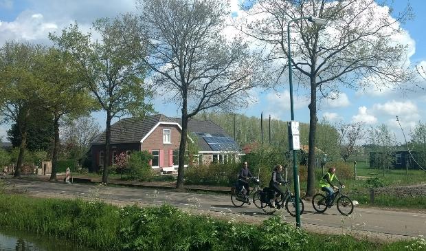 <p>Fietsend op de Langbroekerdijk bij De Weide Blik</p>