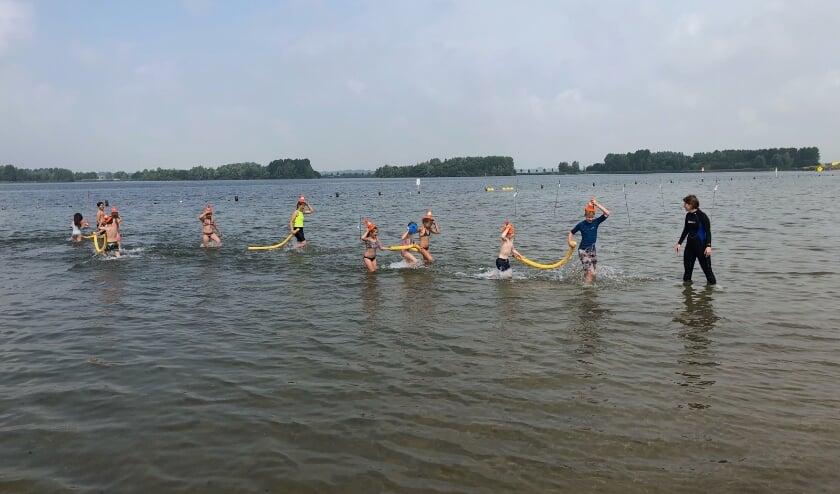 Bij de zwemclinic komt onder andere het verschil tussen natuurwater en zwembadwater aan bod.