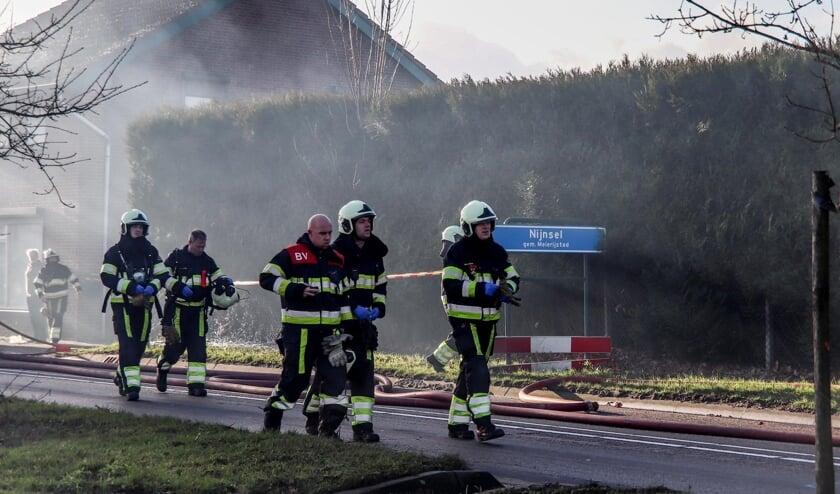 De brandweer is druk in de weer.   | Fotonummer: c3ddf8