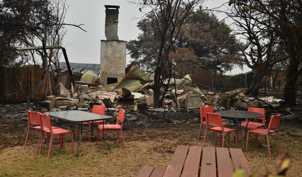 Natuurbranden in Australië hebben al vier miljoen hectare verwoest.  (beeld PETER PARKS / AFP)