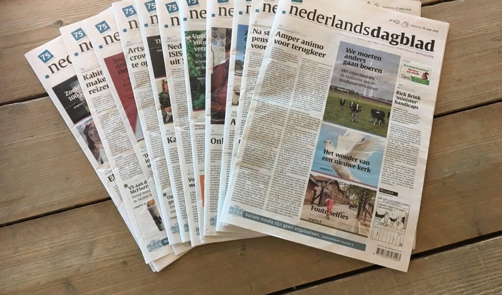 Advertentieverkoop en redactie zijn gescheiden.  het Nederlands Dagblad bij haar 75-jarig jubileum.  (beeld nd)