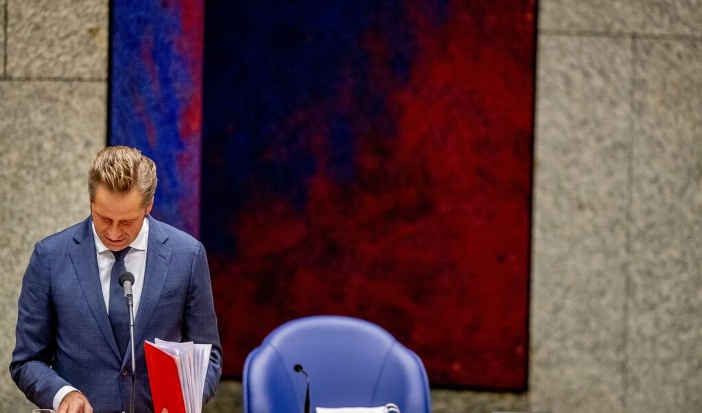 Minister Hugo de Jonge van Volksgezondheid tijdens het debat over het coronavirus.  (beeld anp / Robin Utrecht)
