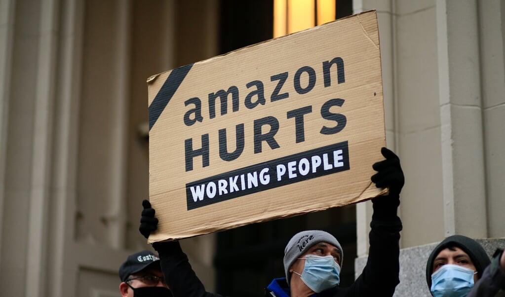 'Berichten over onderbetaalde werknemers houden de groei van Amazon niet tegen.'  (beeld afp / Kena Betancur)