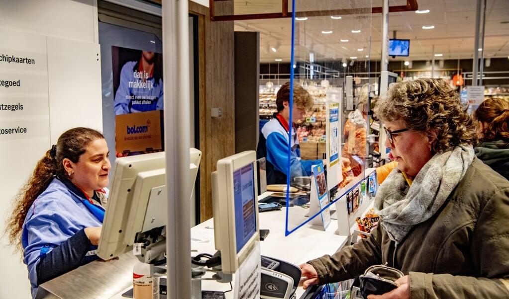 We zijn met elkaar mede-eigenaar van grote schakels in de voedselketen, zoals Albert Heijn en Unilever.  (beeld anp / Robin Utrecht)