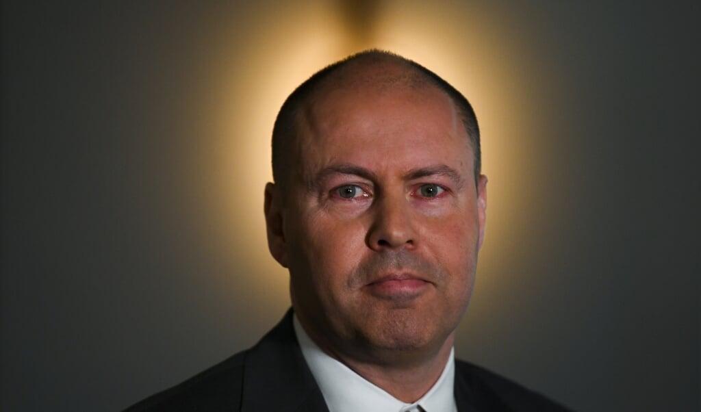 Minister van Financiën Josh Frydenberg: 'Wij gaan niet in op dwang en dreigementen, waar ze ook vandaan komen.'  (beeld epa / Lukas Coch)