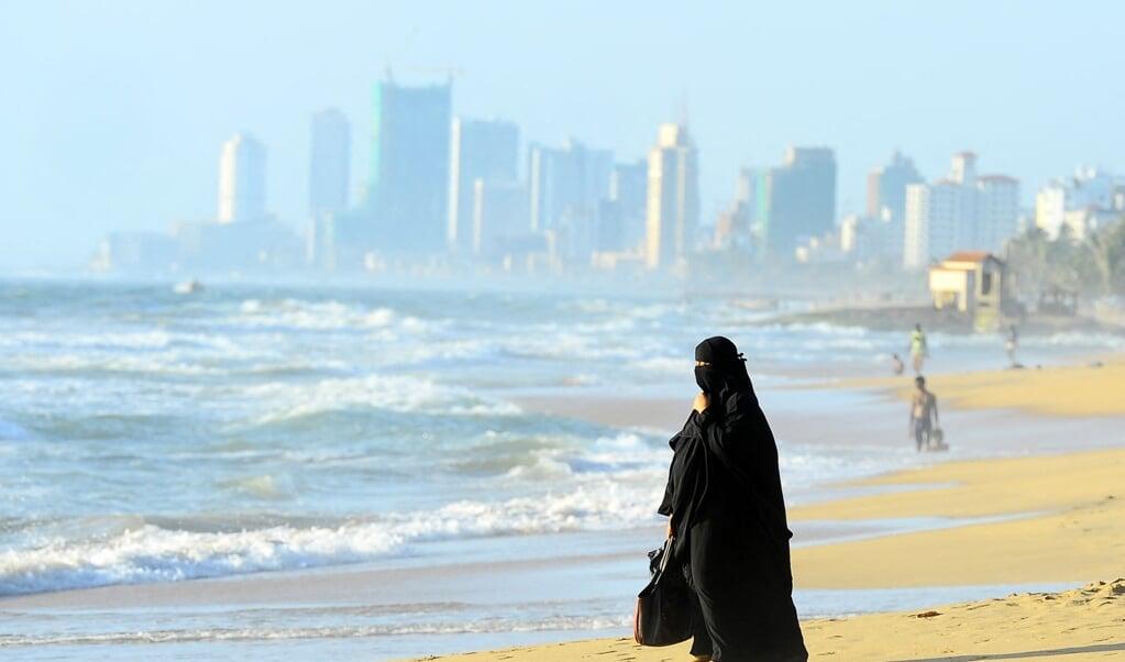Zo'n 9 procent van de Sri Lankaanse bevolking is moslim. Een andere minderheid zijn de Tamils, zo'n 15 procent van de bevolking. Meer dan 70 procent is boeddhist.   (beeld afp / Lakruwan Wanniarachchi)
