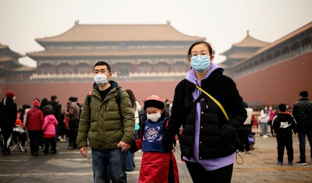 De huidige krimp wordt veroorzaakt door de eenkindpolitiek, in 1980 ingevoerd na voorspellingen over de bevolkingsaanwas op basis van de gemiddelde gezinsgrootte van zes kinderen uit de late Mao-jaren.   (beeld afp / Noel Celis)
