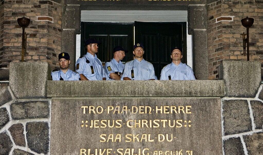 Denemarken heeft al jaren een streng migratiebeleid. In 2009 viel de politie een kerk in Kopenhagen binnen om asielzoekers op te pakken.  (beeld afp / Hagemann Bro Andreas)
