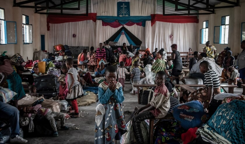 2021-05-28 10:26:36 Displaced children form Goma, who lost their parents while fleeing the Mount Nyiragongo eruption, are seen sheltered in a church in Sake, 25km Nort-West of Goma, on May 28, 2021. The eastern Democratic Republic of Congo city of Goma was almost deserted on May 28, 2021 after residents fled following a warning that the Mount Nyiragongo volcano might erupt again. Goma, located on the shore of Lake Kivu, has been on edge since Africa's most active volcano erupted on May 22, 2021 leaving 32 people dead. Guerchom Ndebo / AFP  (beeld afp / Guerchom Ndebo)