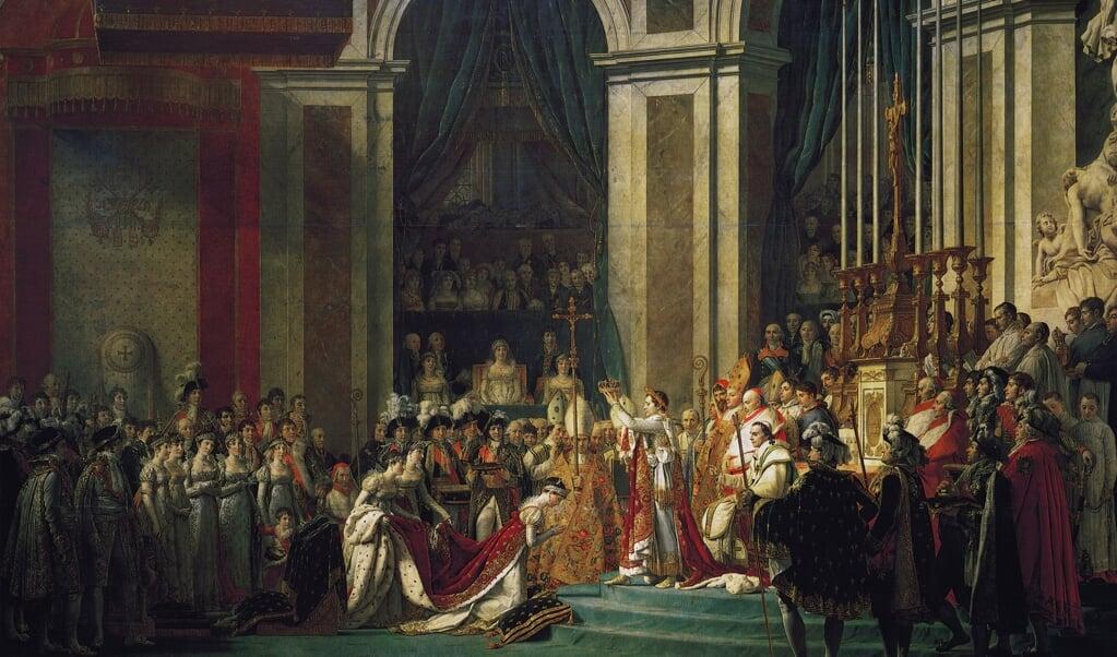 Kroning van keizer Napoleon op 2 december 1804 in de Notre-Dame van Parijs. De kroning vond plaats in aanwezigheid van paus Pius VII. Schilderij van Jacques-Louis David.  (beeld wikipedia / Jacques-Louis David)