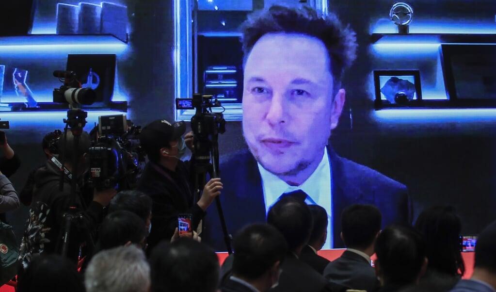 Elon Musk spreekt online tijdens een forum in China. De baas van Tesla heeft de rol van crypto-orakel op zich genomen.  (beeld epa / Wu Hong)