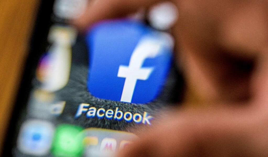 Honderden reacties zijn op Facebook geplaatst naar aanleiding van het seksisme-onderzoek.  (beeld  mladen Antonov / afp)