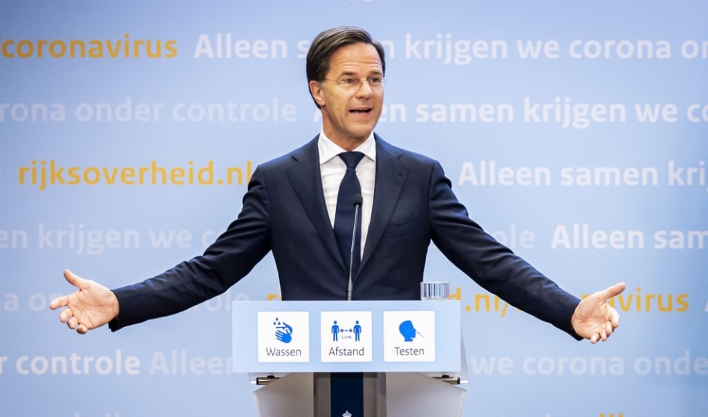 Demissionair premier Mark Rutte tijdens een persconferentie over het coronavirus.  (beeld anp / Remko de Waal)