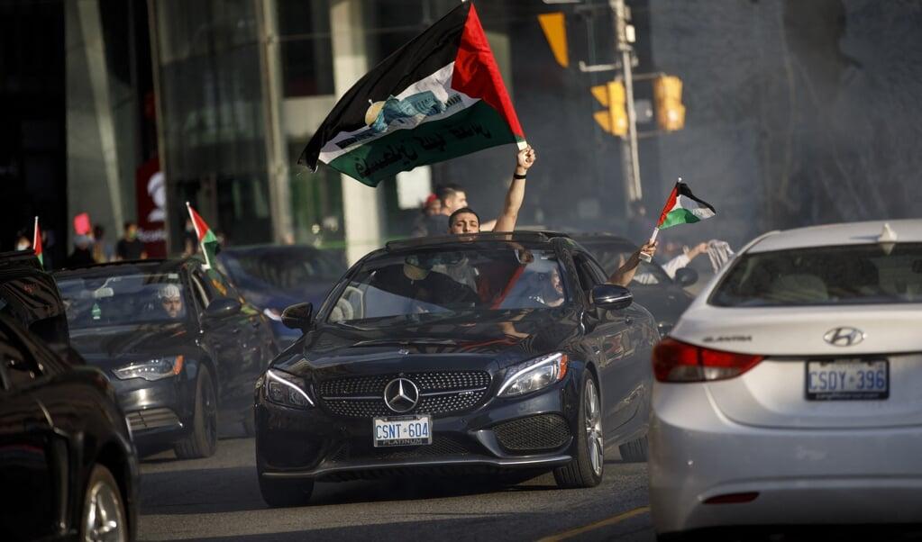 Pro-Palestijnse jongeren reden door Canadese steden en belden aan bij woningen: 'Wonen hier Joden?'  (beeld afp / Cole Burston)