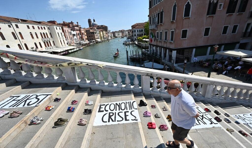 Protest in Venetië tegen de vergadering van G20-landen.  (beeld afp / Andreas Solaro)